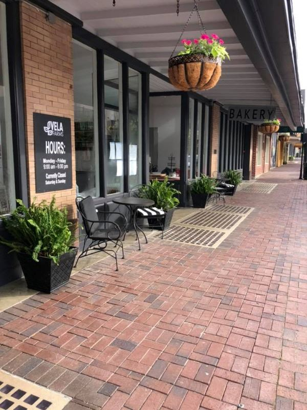 Vela Farms Store front with sidewalk dining.