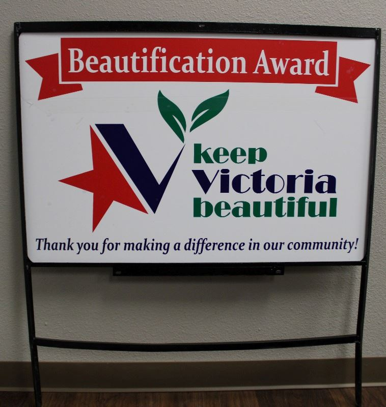 "Sign with KVB logo reads ""Beautification Award. Thank you for making a difference in our communit"